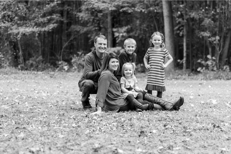 fall_family_in_leaves_black_and_white